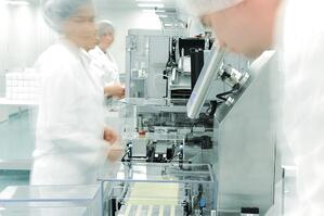 Workers in motion at modern drug factory-1